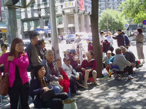 Protesters have conducted a peaceful sit-in outside of the MFA since mid-June 2013. At one point, around 200 participants took part before Beijing police forcibly cleared them away.